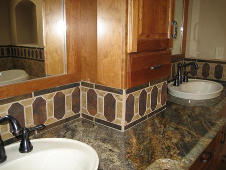 Handmade custom tile treatment and Kohler sinks