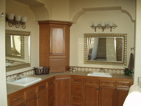Bathroom with arch treatments above mirrors and Kohler sinks