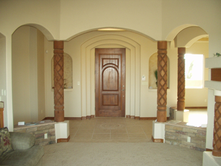 Concentric arches and custom carved columns with custom front door