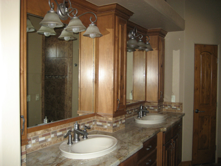 Mirrors are custom built to match the cabinets.  Kohler sinks.